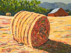 Large Hay Bale with Red Barn